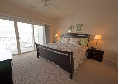 The master bedroom has a view of the lake and its own private bathroom.