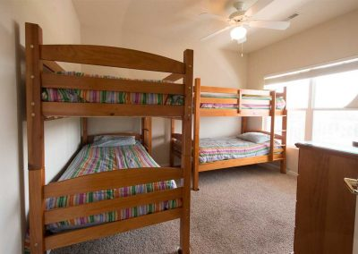 The third bedroom has two bunk beds to accommodate four people.