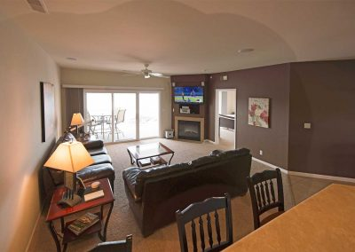 The living room features a fireplace, 50″ LCD TV and gorgeous views.